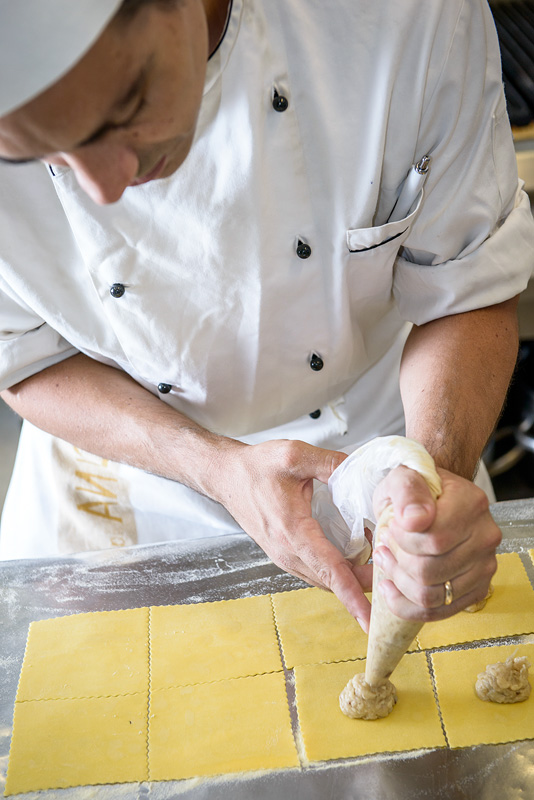 Chef preparing ravioli in the kitchen of Boccanegra Restaurant and Osteria in Florence