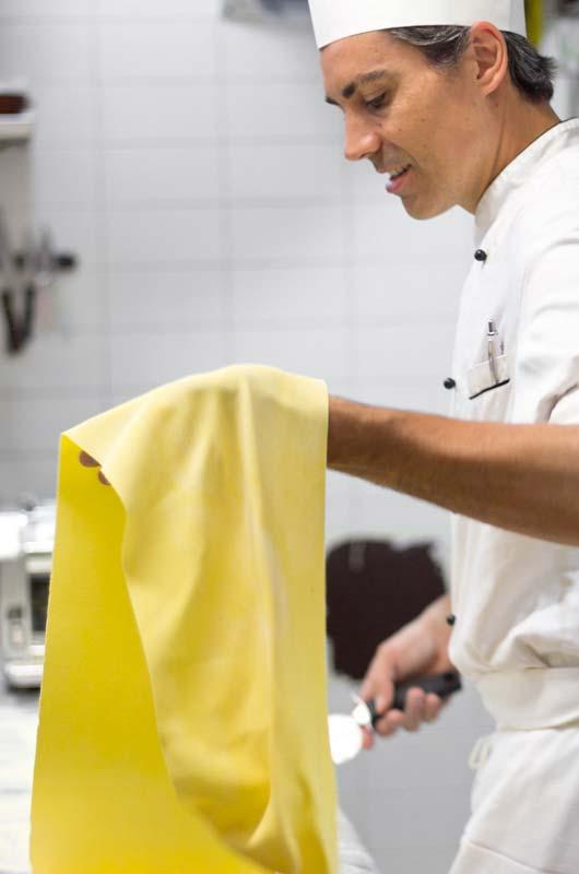 Chef Alessandro preparing fresh pasta at Boccanegra Florence Restaurant