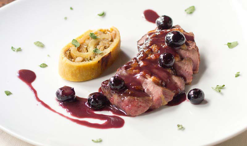 Duck breast and blueberrieswith cabbage hood and pine nuts rollè - Boccanegra Florence Restaurant