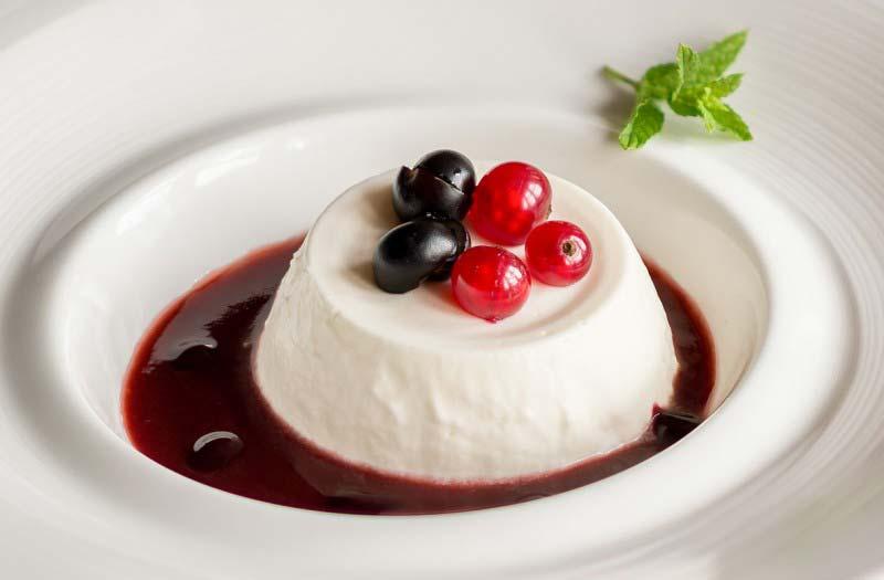 Milk cream pudding with wild berries sauce - Boccanegra Florence restaurant