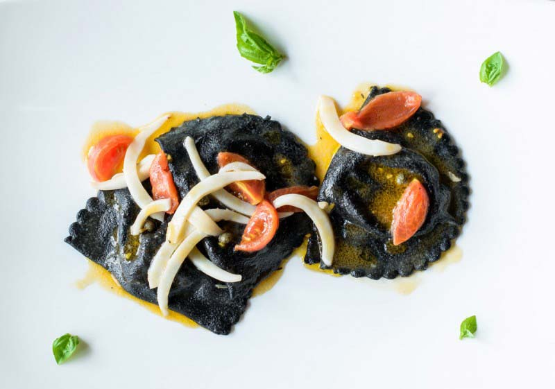 """Mezzelune"" black ravioli of sea bass with cuttlefish, capers and cherry tomatoes - Boccanegra Florence Restaurant"