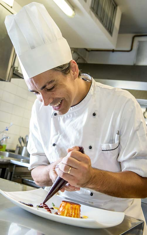 Chef Alessandro preparing a dessert at Boccanegra Restaurant in Florence