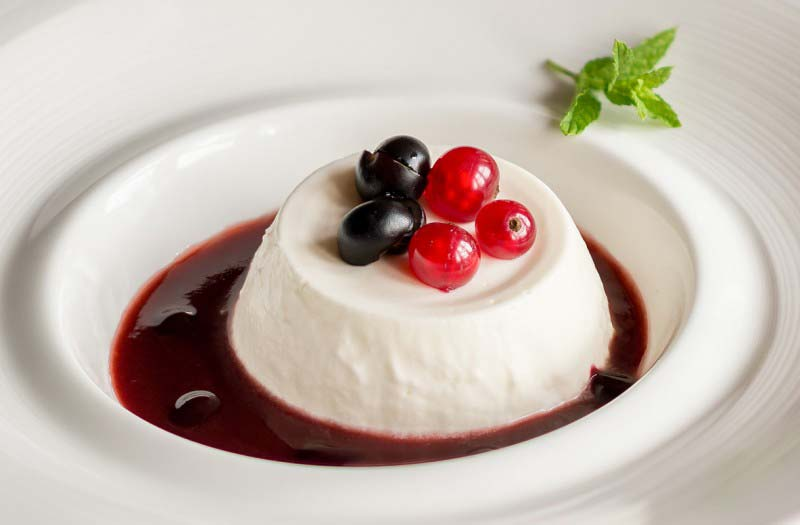 Milk cream pudding with wild berries sauce - Boccanegra Florence restaurant
